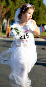 A young diva runs in the Missoula Diva Day 5K.